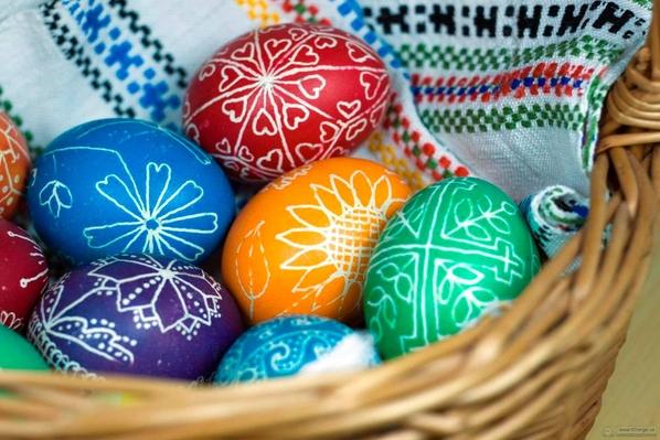 Coloured eggs in a wicker basket
