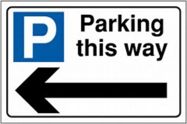 Sign with arrow saying parking