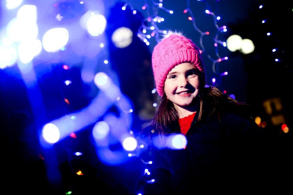 Little girl with Christmas lights